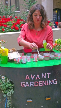 Polly dispensing wild flower seed prescriptions at City of London Festival